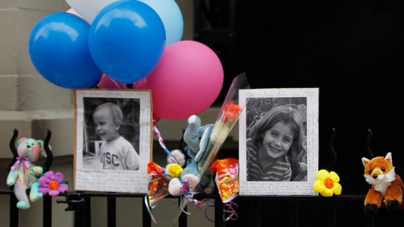 Image via AP. In this Oct. 27, 2012 file photo, photographs of six-year-old Lucia Krim and her 2-year-old brother, Leo, are displayed alongside balloons and stuffed animals at a memorial outside the apartment building were they lived in New York.