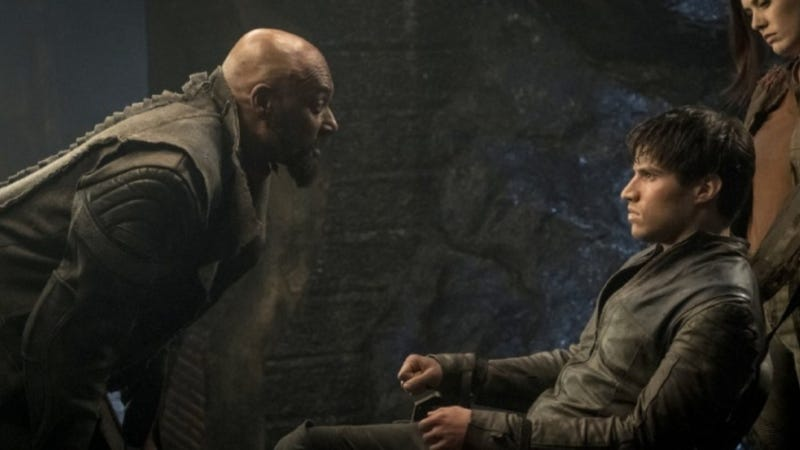 Seg (Cameron Cuffe, right) is also consternated by the arrival of the no-longer-mysterious character played by Colin Salmon (left)