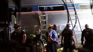 Emergency workers search for the injured after an Amtrak passenger train carrying more than 200 passengers from Washington, D.C., to New York City derailed May 12, 2015, in North Philadelphia. At least seven people were killed and more than 50 others were injured in the crash.Mark Makela/Getty Images