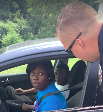 Driver being stopped in Halifax, Va., by police giving out ice cream cones instead of ticketsFacebook