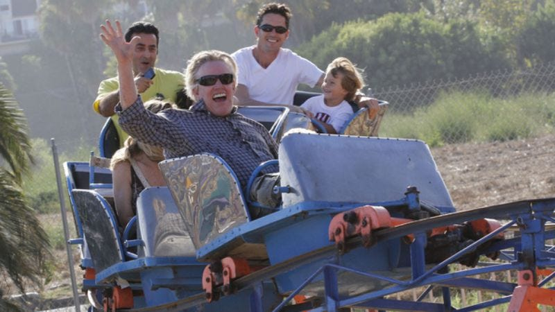 Illustration for article titled It's Friday, so here are photos of Gary Busey on a roller coaster and Nick Nolte riding a bumper car