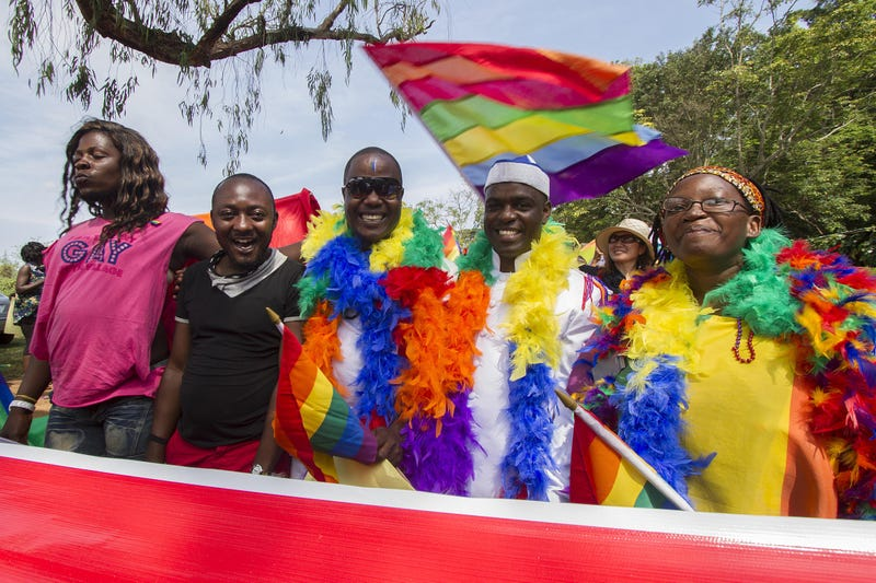 People hold rainbow flags as they take part in the gay-pride parade in Entebbe, Uganda, on Aug. 8, 2015.ISAAC KASAMANI/AFP/Getty Images