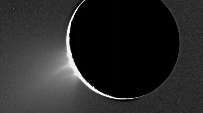 This image of Saturn's moon Enceladus, taken by the Cassini probe in 2005, shows plumes of material over its south pole.