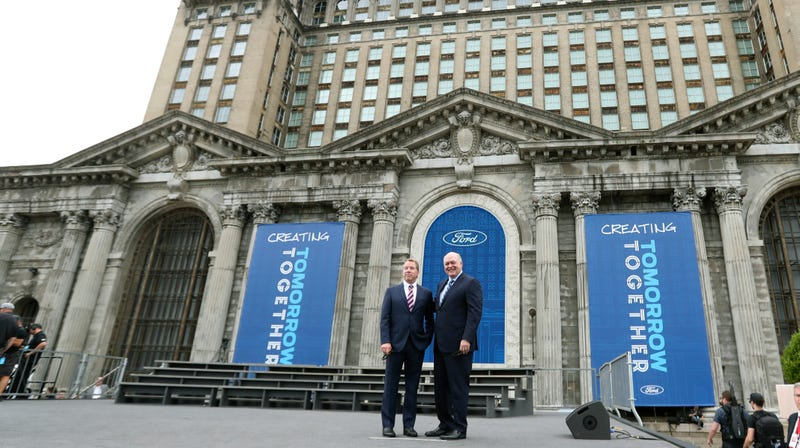Bill Ford Jr. and Jim Hackett outside Ford's new property in Detroit