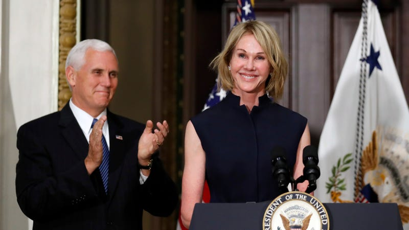 Vice President Mike Pence applauds as U.S. Ambassador to Canada Kelly Knight Craft.