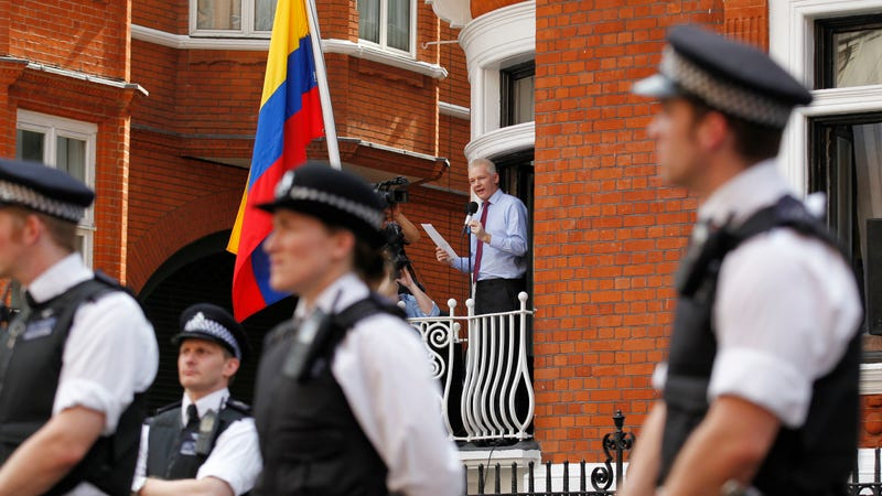 Assange surrounded by police outside the Ecuadorian Embassy in 2012.