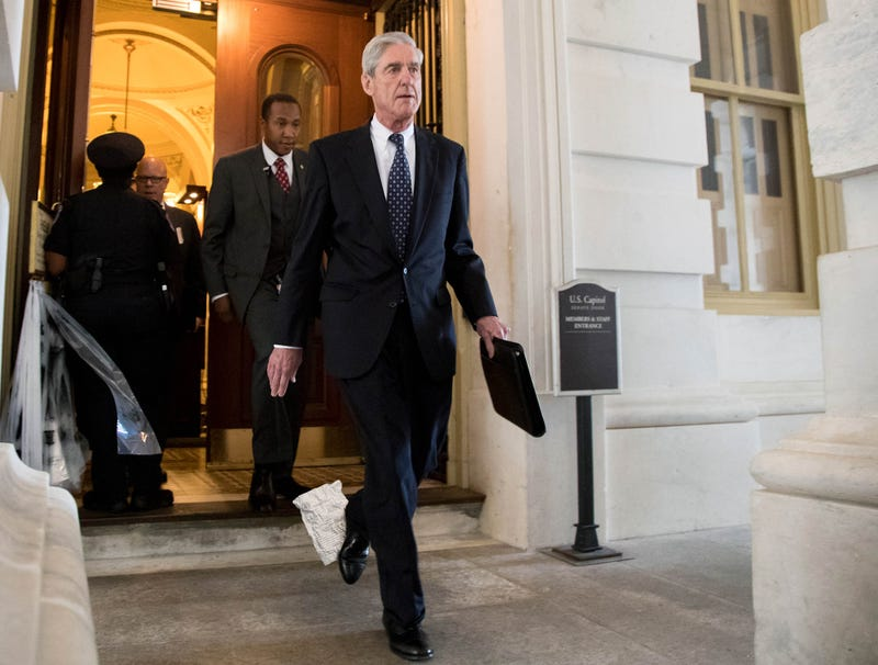 Illustration for article titled Frazzled Robert Mueller Walking Around With Piece Of Russia Investigation Document Stuck To His Shoe