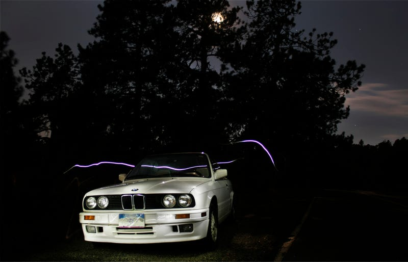 Illustration for article titled E30 Cabrio+ Colorado Mountain + Moonlight + iPhone Flashlight = Well, This: