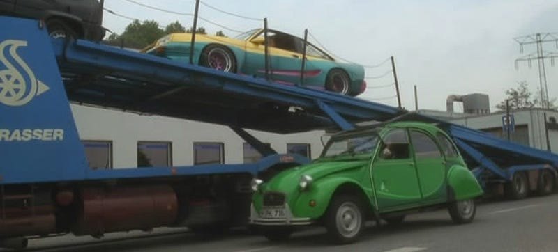 An 'I Fly Bleifrei' edition Citroën 2CV, once advertised as clean, now seen as an eco menace. Screenshot taken from the 1991 film Manta, Manta