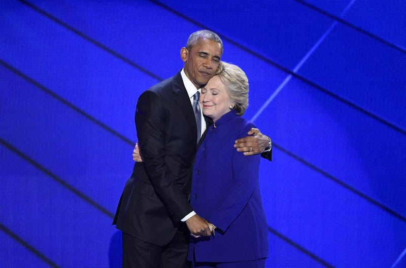 President Barack Obama hugs Hillary Clinton, the 2016 Democratic presidential nominee, onstage during the Democratic National Convention in Philadelphia on July 27, 2016. David Paul Morris/Bloomberg via Getty Images