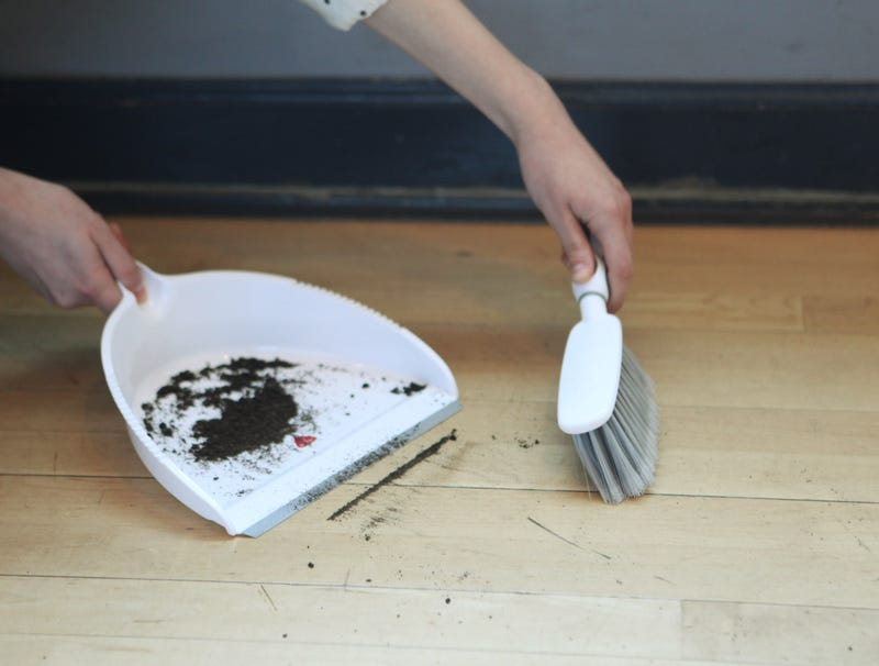 Illustration for article titled Narrow Line Of Dirt Not Being Swept Into Dustpan Without A Fight