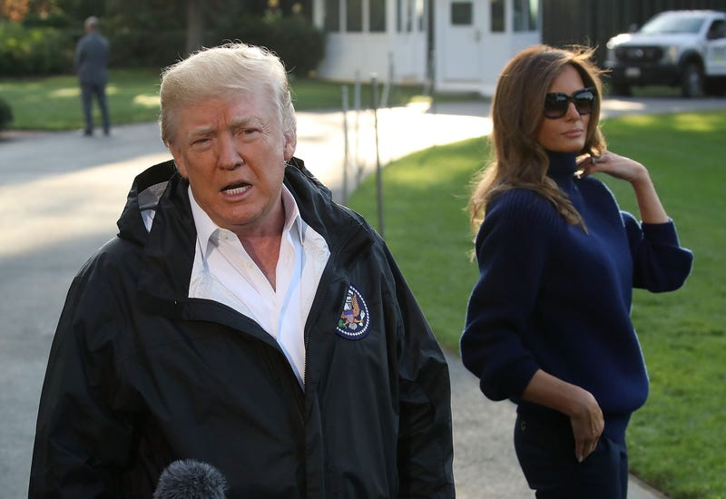 President Donald Trump speaks to the media while flanked by first lady Melania Trump before departing on Marine One from the White House for Puerto RIco on Oct. 3, 2017. (Mark Wilson/Getty Images)