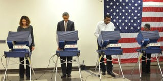 President Obama with other 2012 voters (Mandel Ngan/AFP/Getty Images)