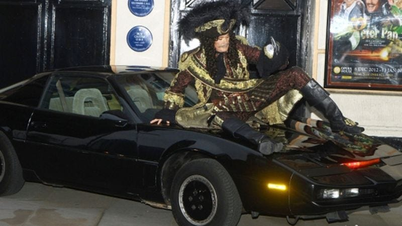 Illustration for article titled It's Friday, so here's a photo of David Hasselhoff sitting on KITT while dressed as a pirate