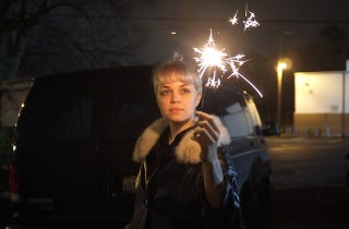 Sparklers hanging from pussy