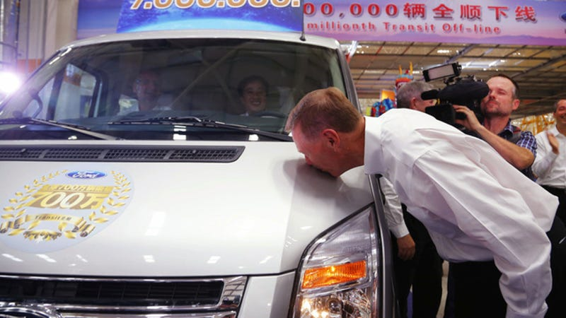 Illustration for article titled Alan Mulally Makes Out With The Seven Millionth Ford Transit Van