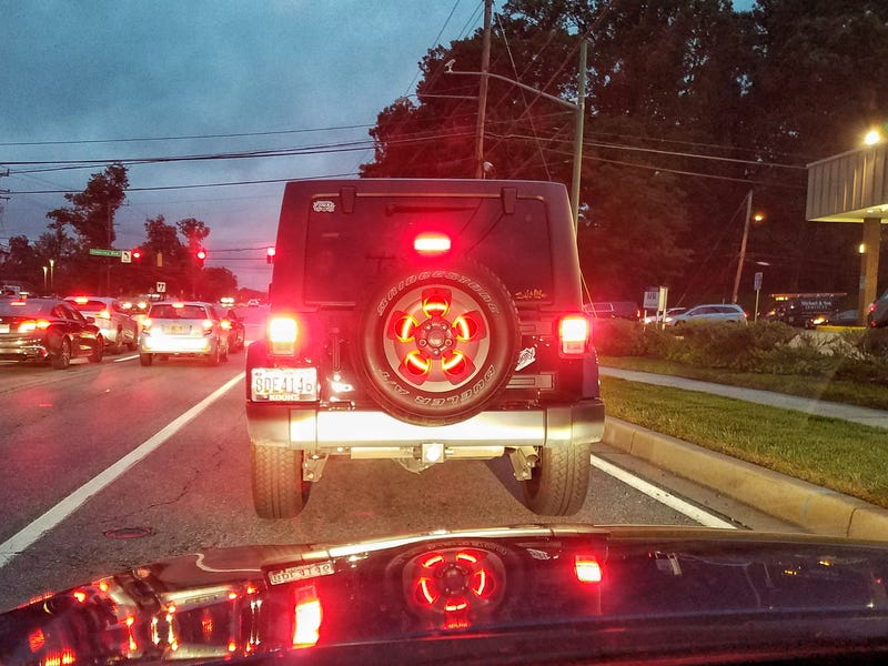 Illustration for article titled Are we allowed to like this brake light ring in a Wrangler spare tire?