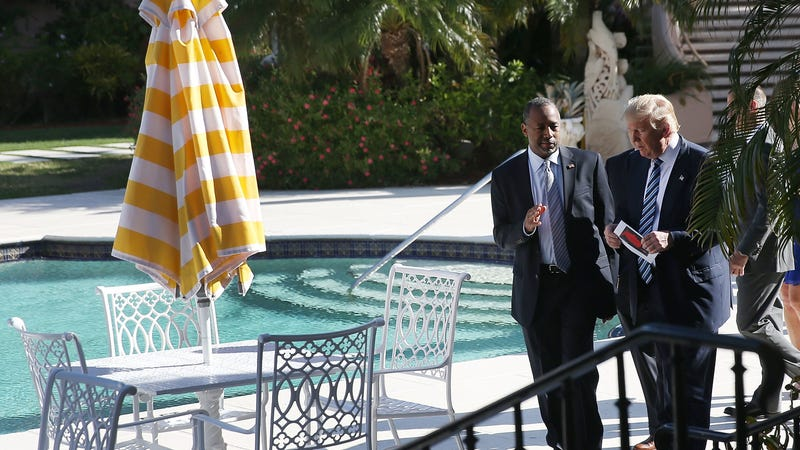Then-candidate Donald Trump speaks with Dr. Ben Carson, now the secretary of Housing and Urban Development, by a pool at the Mar-a-Lago Club in 2016.