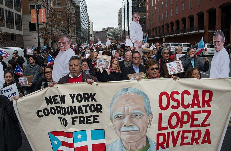 People march to demand the release of Puerto Rican nationalist Oscar Lopez Rivera near the White House in Washington, DC, on January 11, 2017. NICHOLAS KAMM/AFP/Getty Images
