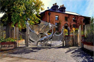Illustration for article titled House Guarded By Dragon Gate Can Be Yours For Only 2.4 Million Euros