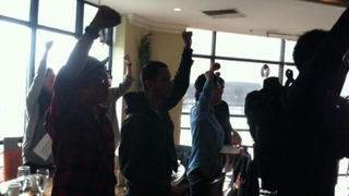 """""""Black Brunch"""" protesters and store patrons stand with their fists raised to honor black lives lost to police brutality.Twitter"""