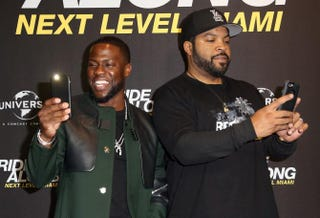 Kevin Hart and Ice Cube take pictures with their mobile phones during a photo call for the film Ride Along 2: Next Level Miami at Kino in der Kulturbrauerei on Jan. 18, 2016, in Berlin.Adam Berry/Getty Images