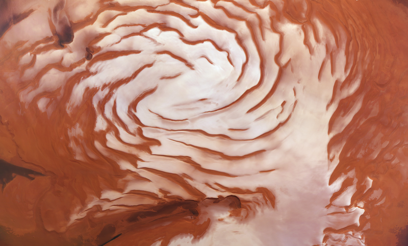 A mosaic image produced with the High Resolution Stereo Camera on the Mars Express spacecraft, which shows spiral features used to interpret ice advancement and retreat at Mars' north pole. Image: ESA/DLR/FU-Berlin/Ralf Jaumann.