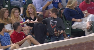 Illustration for article titled Boy Pulls Off The Smoothest Foul Ball Trick To Impress Girl Behind Him