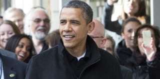 President Obama greets onlookers in Virginia on Nov. 24, 2012. (Pool/Getty Images)