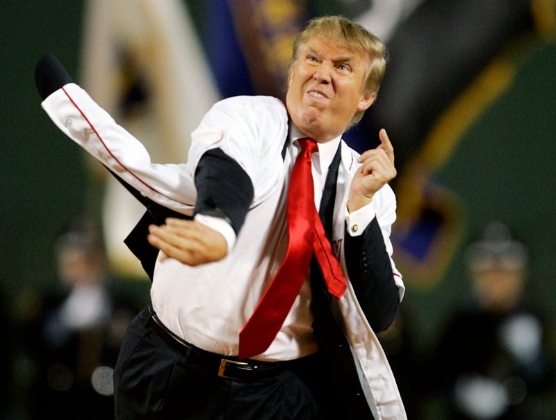 Donald Trump throws out the first pitch at a Red Sox game in 2006.