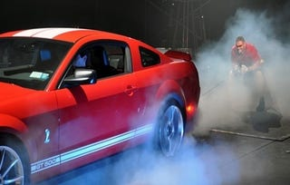 Illustration for article titled Strong Man Holds Back Stampeding Mustang GT500