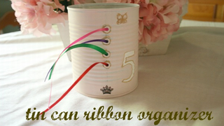 Illustration for article titled Turn a Used Tin Can Into a Ribbon Organizer