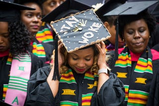 A graduate adjusts her cap as she takes part in the Black Commencement at Harvard University in Cambridge, Mass., on May 23, 2017. One hundred seventy students attended the universitywide ceremony for black students at Harvard, designed to celebrate their unique struggles and achievements at the elite institution.