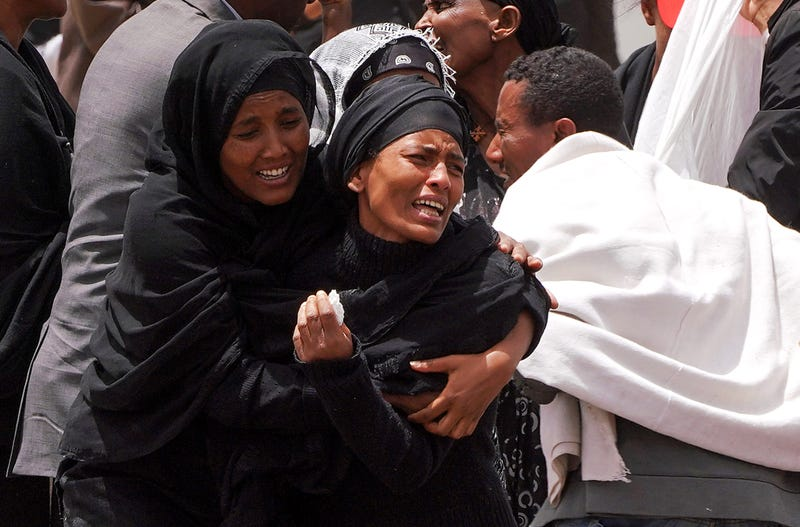 Distraught family members attend a memorial service held for the victims of the Ethiopian Airlines Flight ET302 crash on March 14, 2019, in Ejere, Ethiopia.