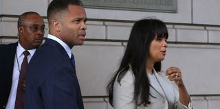 Jesse Jackson Jr. and his wife, Sandi, leave federal court in Washington, D.C., after sentencing. (Mark Wilson/Getty Images)