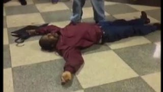 Cellphone video footage of substitute teacher Pewu Johnson lying unconscious surfaced on social media shortly after the alleged incident took place.YouTube