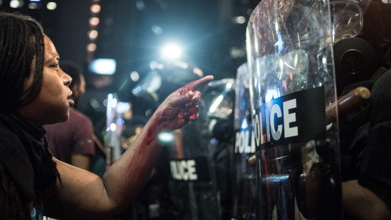 A woman points at a police officer in Charlotte, N.C., on Sept. 21, 2016. (Sean Rayford/Getty Images)