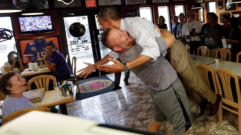 Illustration for article titled POTUS Endures a Bear Hug from the Pizza Demographic