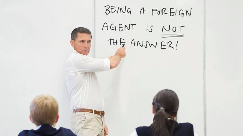 Michael Flynn speaking to a classroom of children.