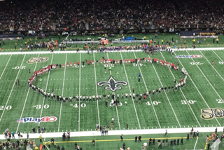 New Orleans Saints and Atlanta Falcons players meet in the middle of the field for a moment of silence.Twitter