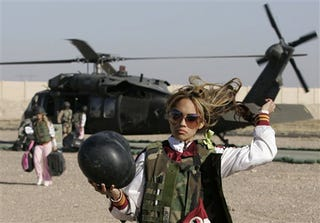 Illustration for article titled Redskins Cheerleader Arrives In Iraq, Promptly Tosses Hair