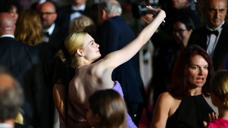 Elle Fanning takes a selfie after Cannes premiere of The Beguiled