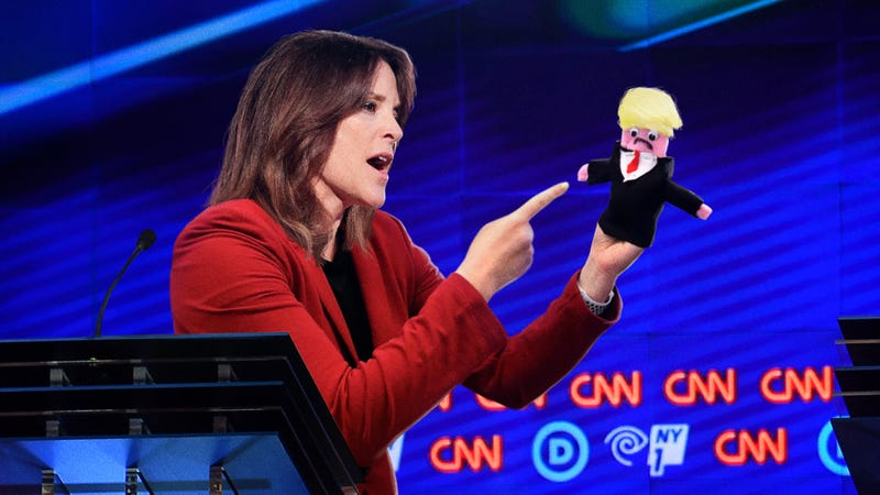 Illustration for article titled Marianne Williamson Sternly Addresses Homemade Trump Puppet About Immigration In Fiery Debate Exchange