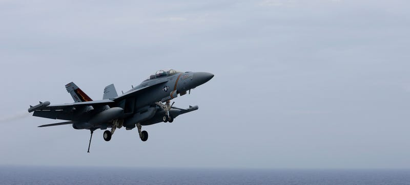 An F/A-18 Hornet approaches the deck of the USS John C. Stennis off of Japan back in June. (AP Photo/Shizuo Kambayashi)