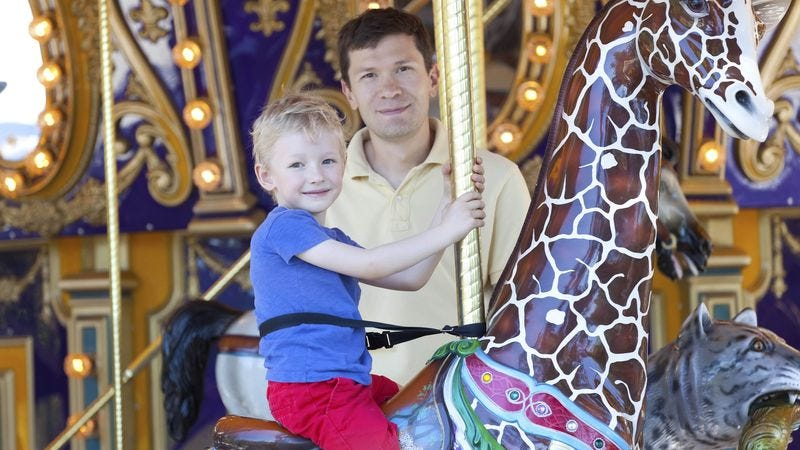 Illustration for article titled Pathetic 4-Year-Old Needs Father To Stand On Merry-Go-Round Platform For Entire Ride