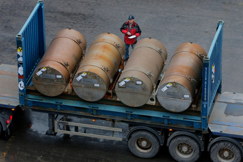 A truck carries containers with low-enriched uranium to be used as fuel for nuclear reactors, on a port in St. Petersburg, Russia, Thursday, Nov. 14, 2013. A 20-year program to convert highly enriched uranium from dismantled Russian nuclear weapons into fuel for U.S. power plants has ended, with the final shipment loaded onto a vessel in St. Petersburg's port on Thursday. The U.S. Energy Department described the program, commonly known as Megatons to Megawatts, as one of the most successful nuclear nonproliferation partnerships ever undertaken. (AP Photo/Dmitry Lovetsky)