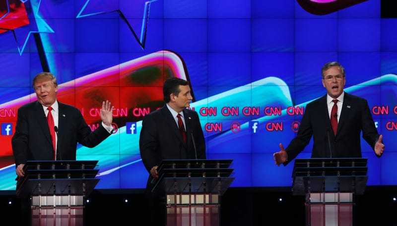 Then-Republican presidential candidates Donald Trump and Jeb Bush (right) respond to each other as Sen. Ted Cruz listens during the CNN Republican presidential debate on Dec. 15, 2015, in Las Vegas.