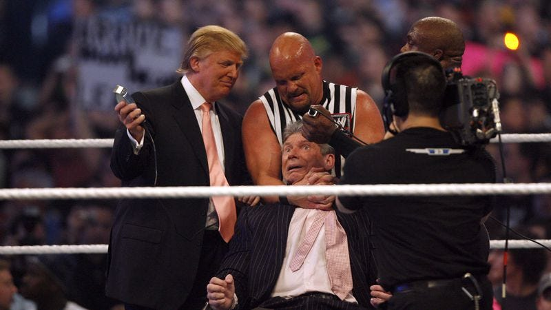 """Donald Trump, Stone Cold Steve Austin and WWE wrestler Bobby Lashley get ready to shave Vince McMahon's head after McMahons lost the main event of the night, """"Hair Vs. Hair,"""" between Vince McMahon and Donald Trump. WrestleMania 23 at Detroit's Ford Field in Detroit, Michigan on April 1, 2007. (Photo: Leon Halip/WireImage/Getty)"""