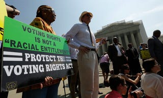 Supporters of the Voting Rights Act listen to speakers discussing the court's rulings outside the U.S. Supreme Court Building on June 25, 2013, in Washington, D.C. (Win McNamee/Getty Images)