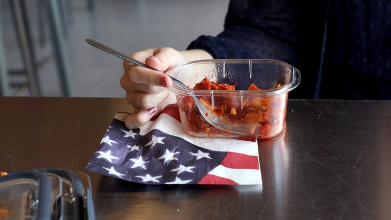 Illustration for article titled A Beautiful Tribute: This Woman Is Using An American Flag-Themed Disposable Napkin In Honor Of Her Country